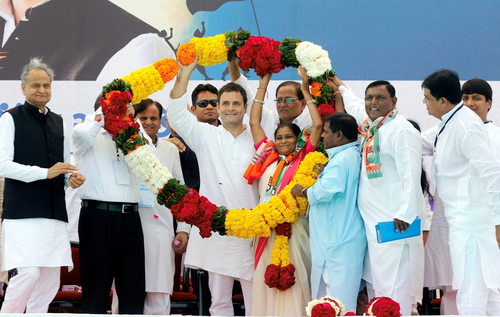 Bharuch: Congress vice-president Rahul Gandhi being garlanded by the supporters during a public meeting in Bharuch on Wednesday. PTI Photo (PTI11 1 2017 000048A)