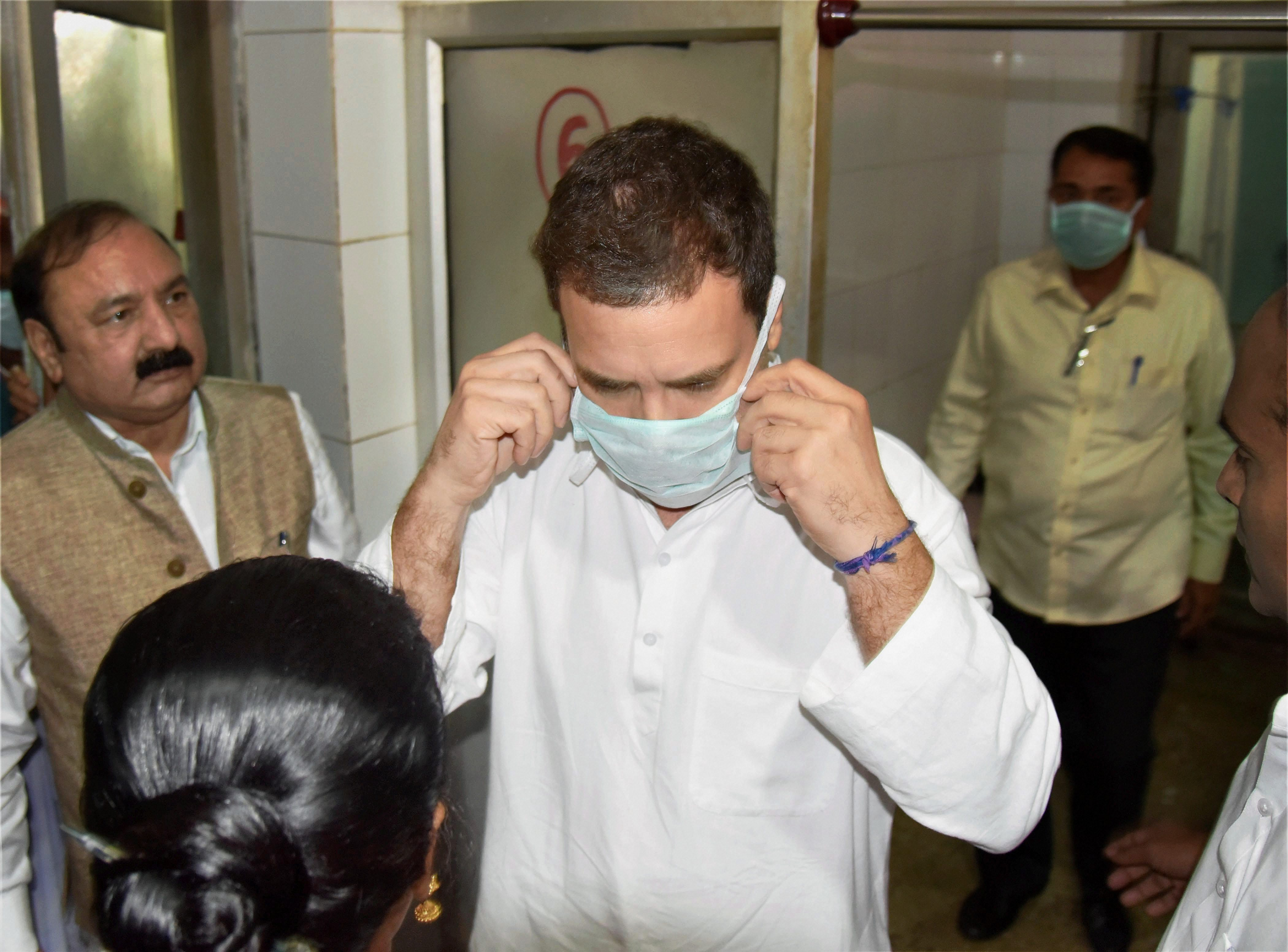 Raebareli: Congress vice-president Rahul Gandhi wears a mask to visit the injured victims of Unchahar NTPC boiler blast at the district hospital, in Raebareli on Thursday. PTI Photo (PTI11_2_2017_000018B)