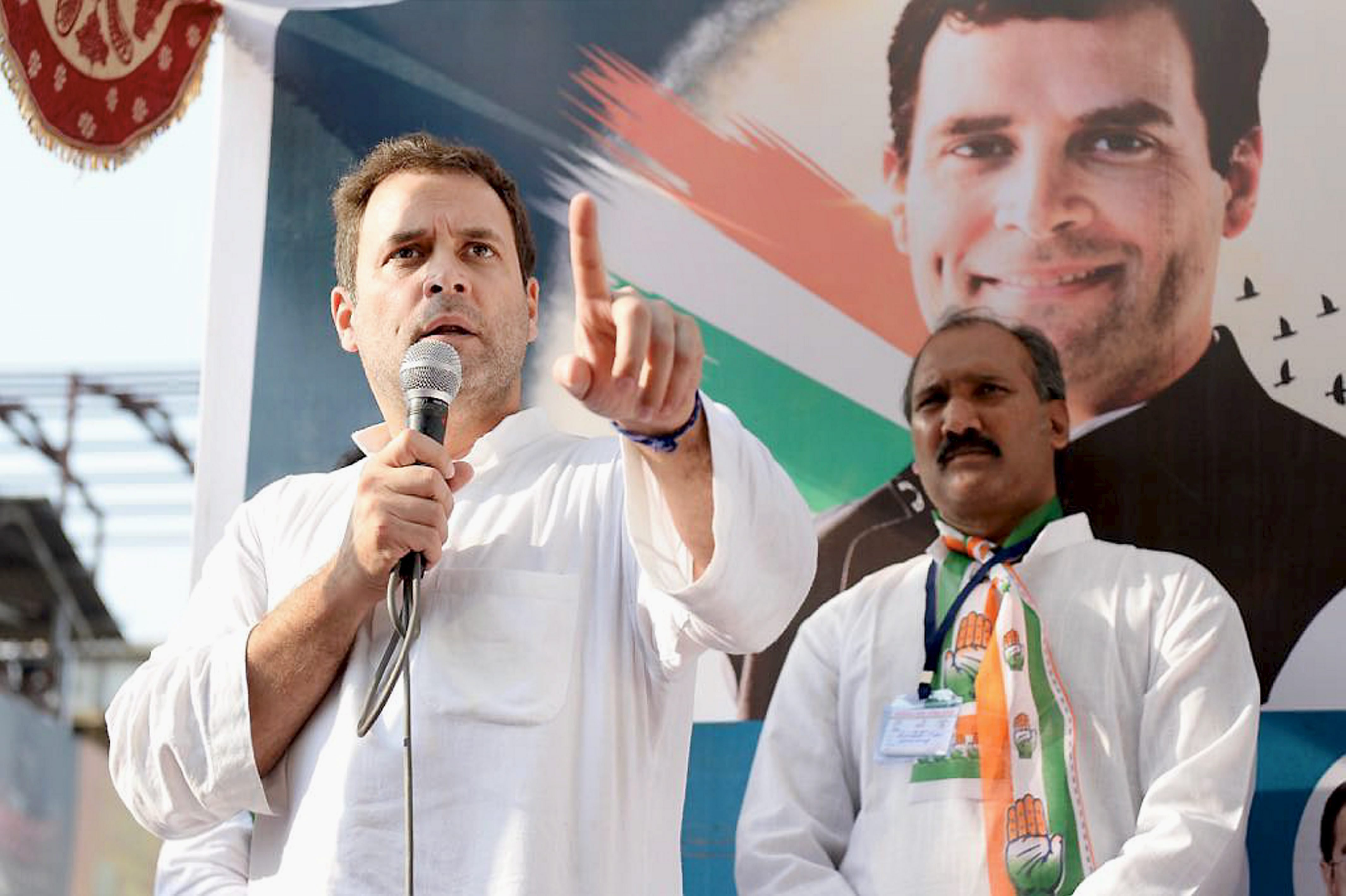 Valsad: Congress vice-president Rahul Gandhi addressing a rally during his road show at Valsad district, in Gujarat on Friday. PTI Photo(PTI11_3_2017_000156B)