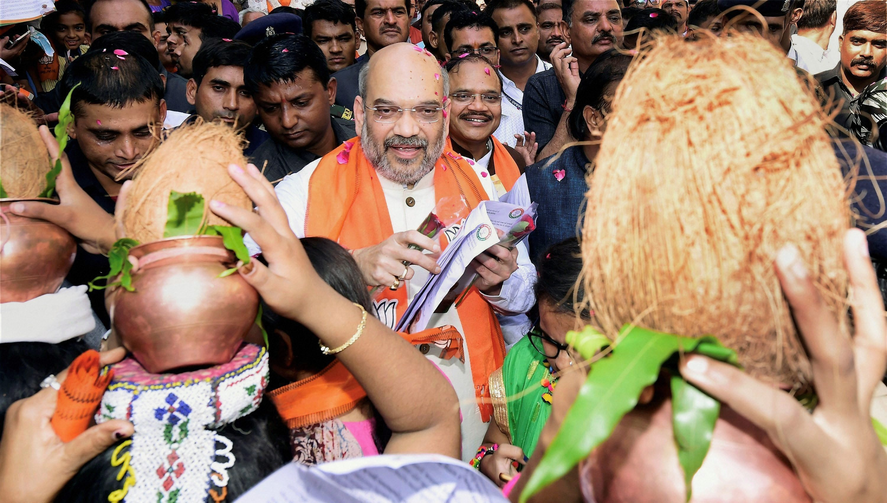 Ahmedabad: BJP National President Amit Shah during his door-to-door campaign for Assembly polls, at Naranpura in Ahmedabad, Gujarat on Tuesday. PTI Photo by Santosh Hirlekar (PTI11_7_2017_000079B) *** Local Caption ***