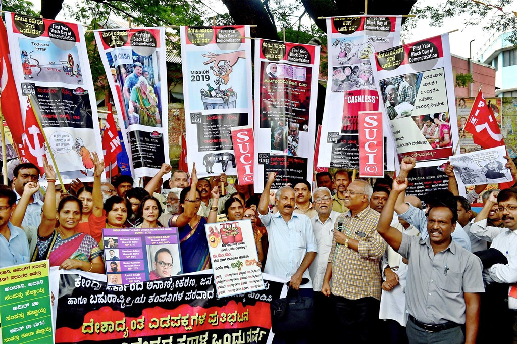 Bengaluru : Members of CPI, SUCI and CPI (ML-L) during a protest against the Demonetisation announcement on its first anniversary, in Bengaluru on Wednesday. PTI Photo by Shailendra Bhojak (PTI11 8 2017 000083B)