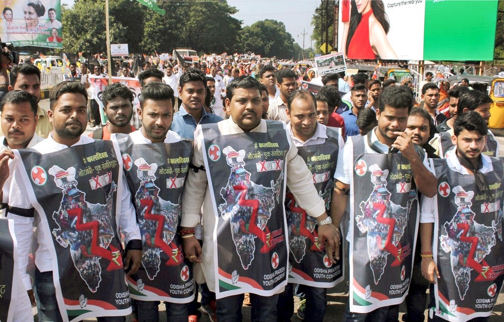 Bhubaneswar: Youth Congress supporters wear black aprons during a protest rally to mark the first anniversary of the Demonetisation announcement by NDA government, in Bhubaeswar on Wednesday. PTI Photo (PTI11 8 2017 000136B)