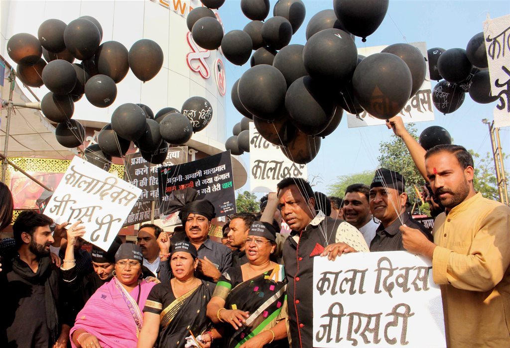 Bhopal: Congress party workers during their Black Day protest against demonetisation on the first anniversary of its announcement, in Bhopal on Wednesday. PTI Photo (PTI11 8 2017 000137A)
