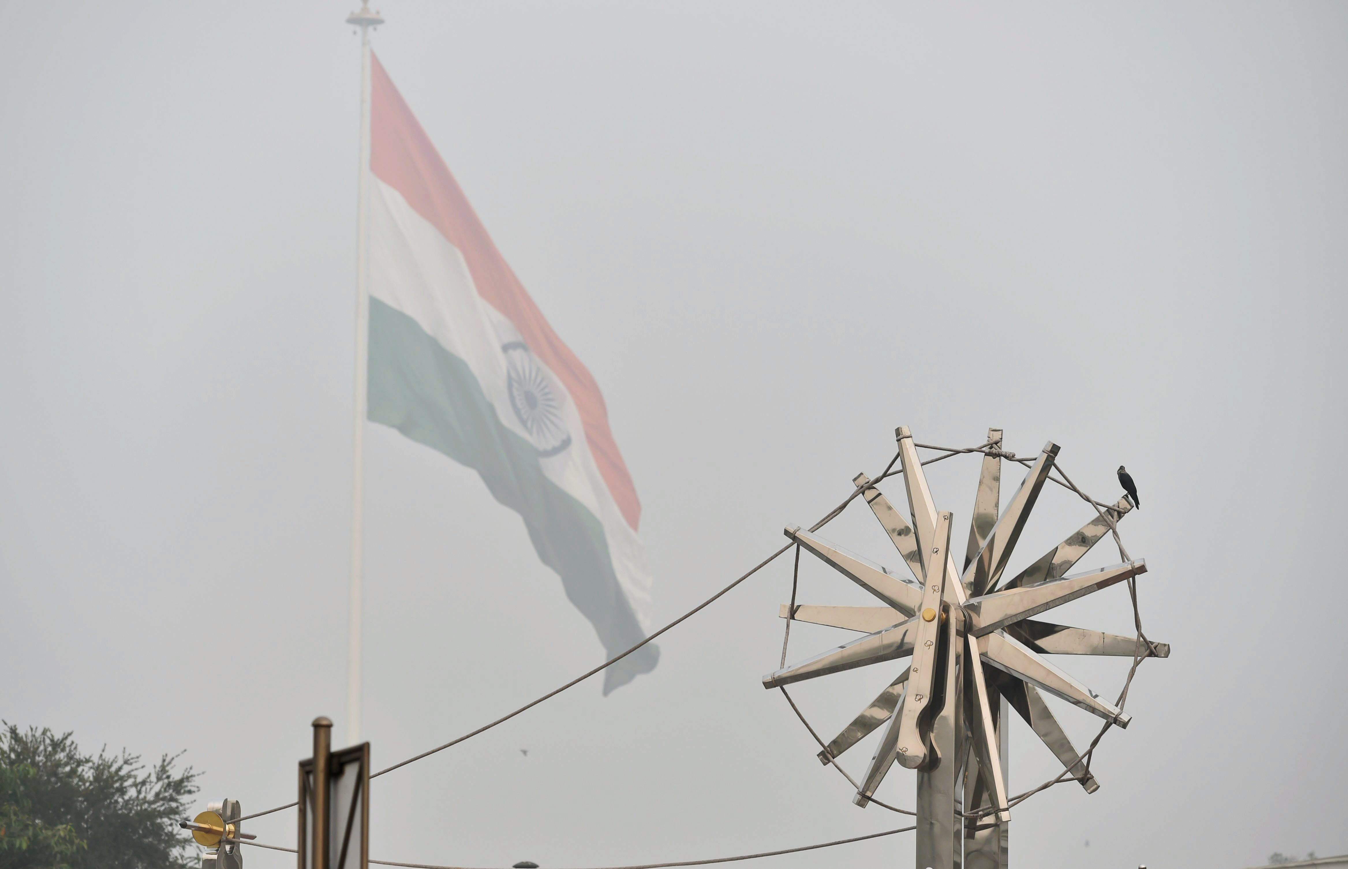 New Delhi: View of the steel ''Charkha'', installed at Rajiv Chowk, enveloped by heavy smog in New Delhi on Wednesday. The smog and air pollution continue to be above the severe levels in Delhi NCR. PTI Photo by Vijay Verma (PTI11_8_2017_000235A)