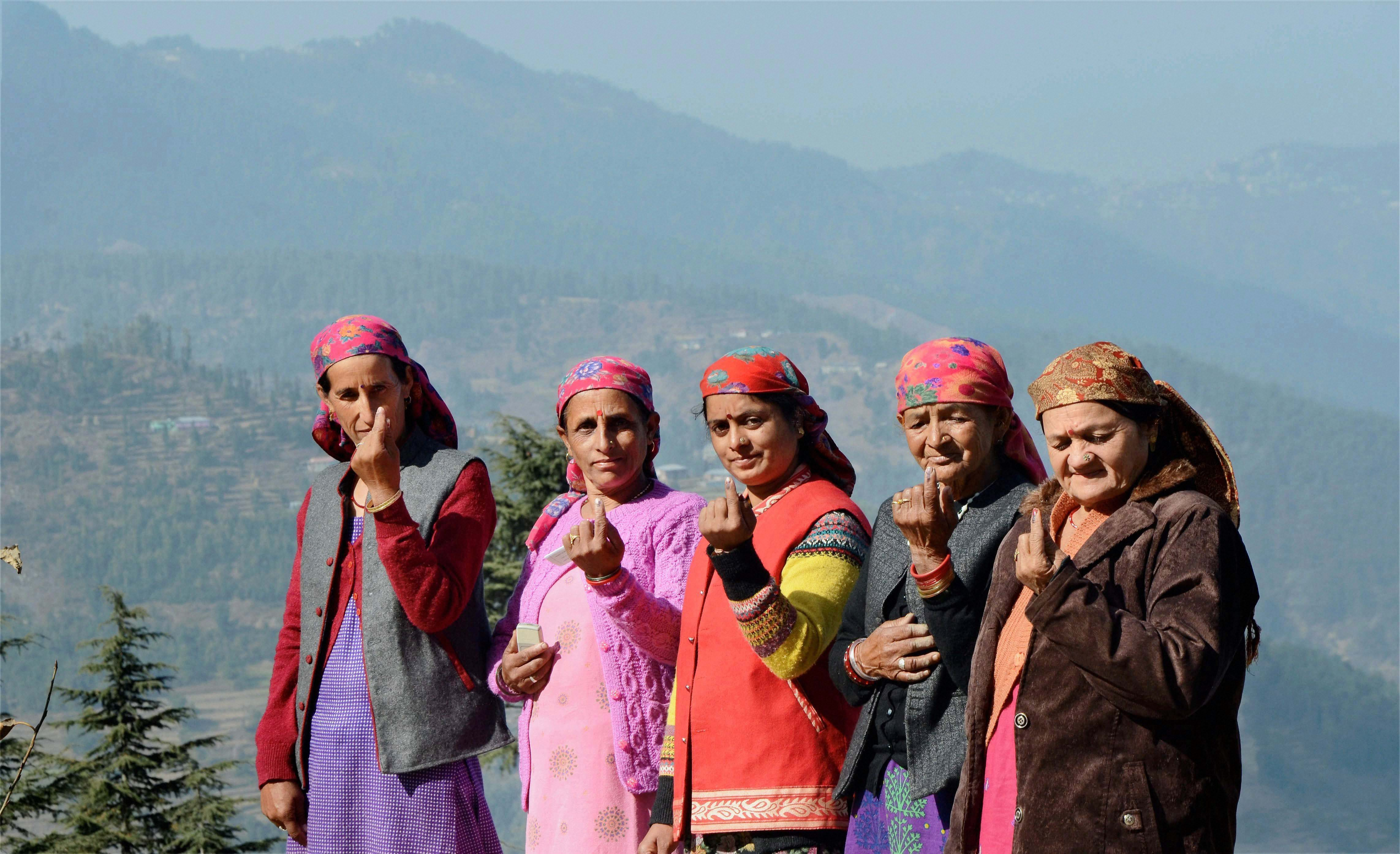 Shimla: A group of women show their inked finger after they cast their vote for the state's Assembly elections, in Shimla on Thursday. PTI Photo(PTI11_9_2017_000029A)
