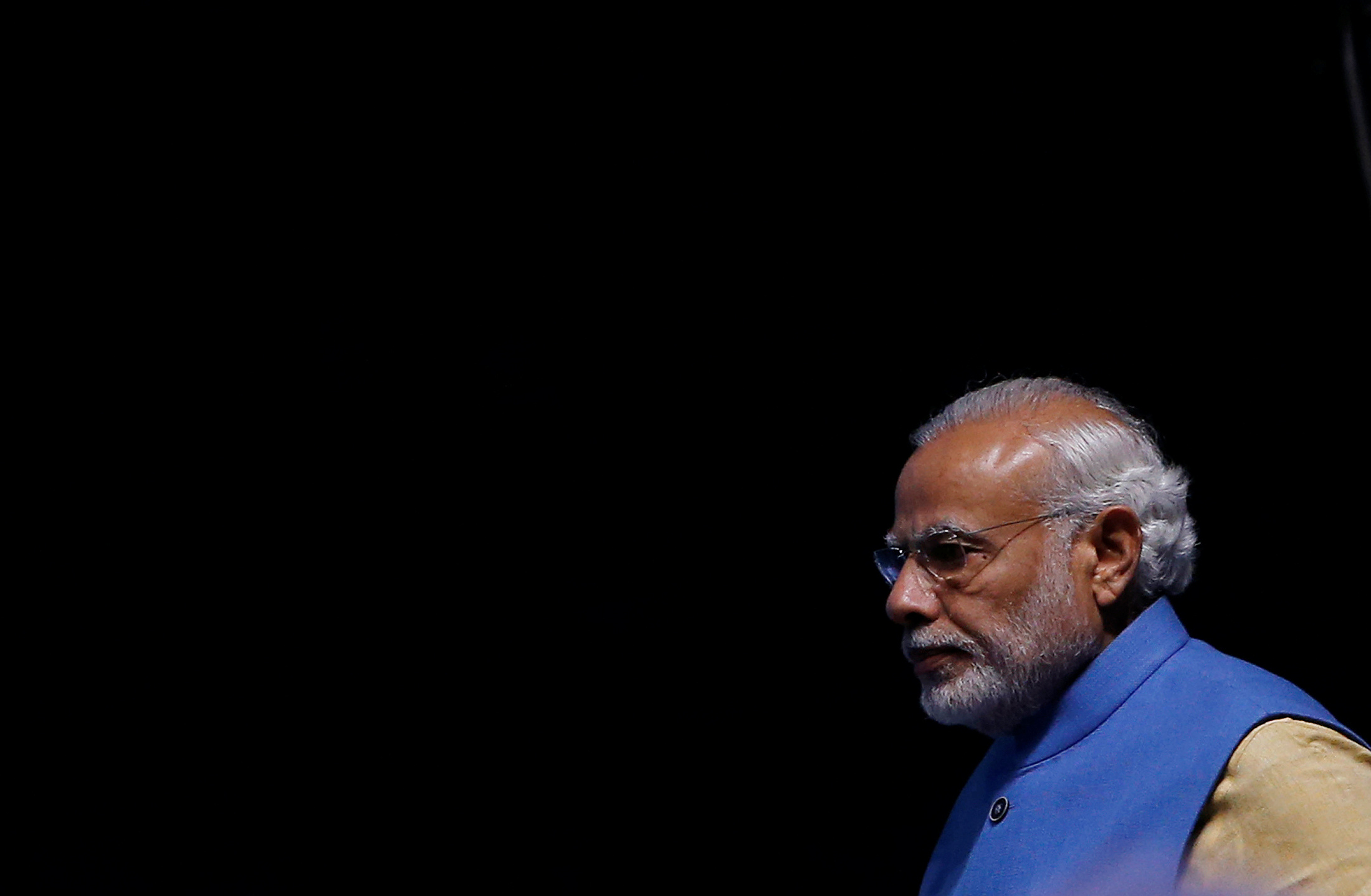 """India's Prime Minister Narendra Modi arrives to launch a digital payment app linked with a nationwide biometric database during the """"DigiDhan"""" fair, in New Delhi, India, December 30, 2016. REUTERS/Adnan Abidi"""