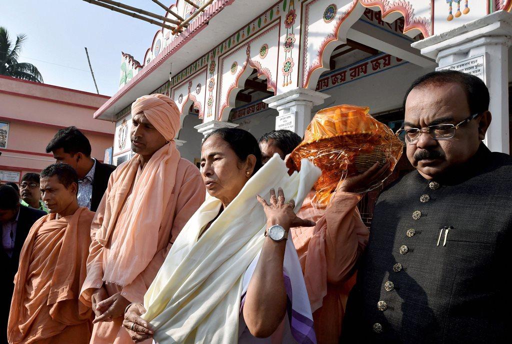 Sagar Island: West Bengal Chief Minister Mamata Banerjee comes out of Bharat Sevashram Sangha Temple after her visit, at Sagar Island on Wednesday. PTI Photo by Swapan Mahapatra (PTI12_27_2017_000145B)