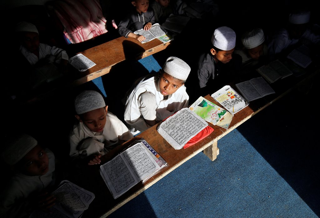Children belonging to Rohingya Muslim community read Koran at a madrasa, or a religious school, at a makeshift settlement, on the outskirts of Jammu, May 6, 2017. Picture taken on May 6, 2017. REUTERS/Mukesh Gupta