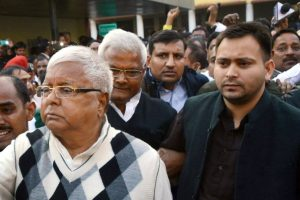 Ranchi: RJD supremo Lalu Prasad Yadav escorted by police officials after being convicted by the special CBI court in a fodder scam case, in Ranchi on Saturday. PTI Photo(PTI12_23_2017_000111B)