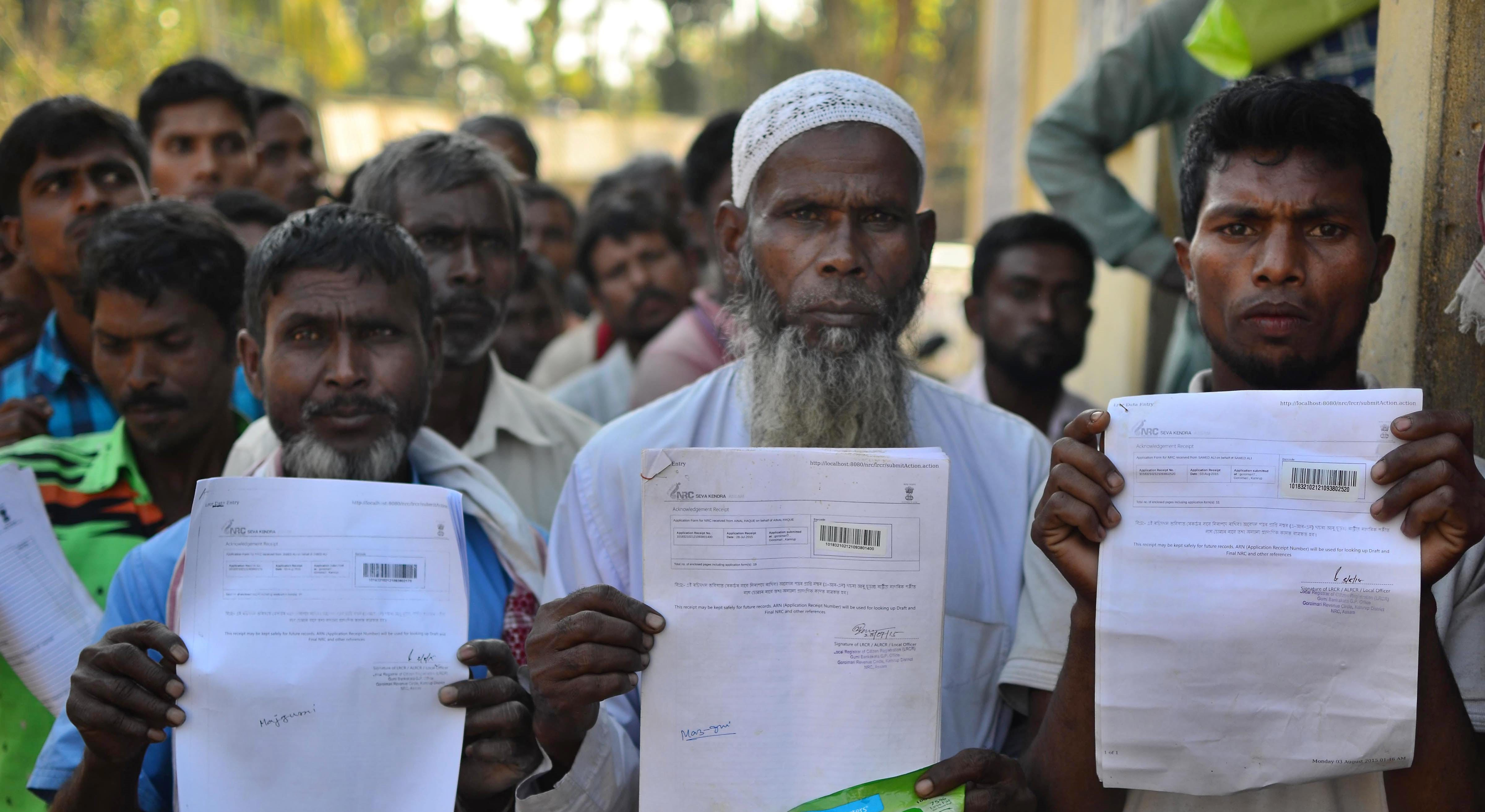Kamrup: People show their acknowledgement receipts after checking their names in a draft for National Register of Citizens (NRC), in Guwahati on Monday. PTI Photo (PTI1_1_2018_000101B)