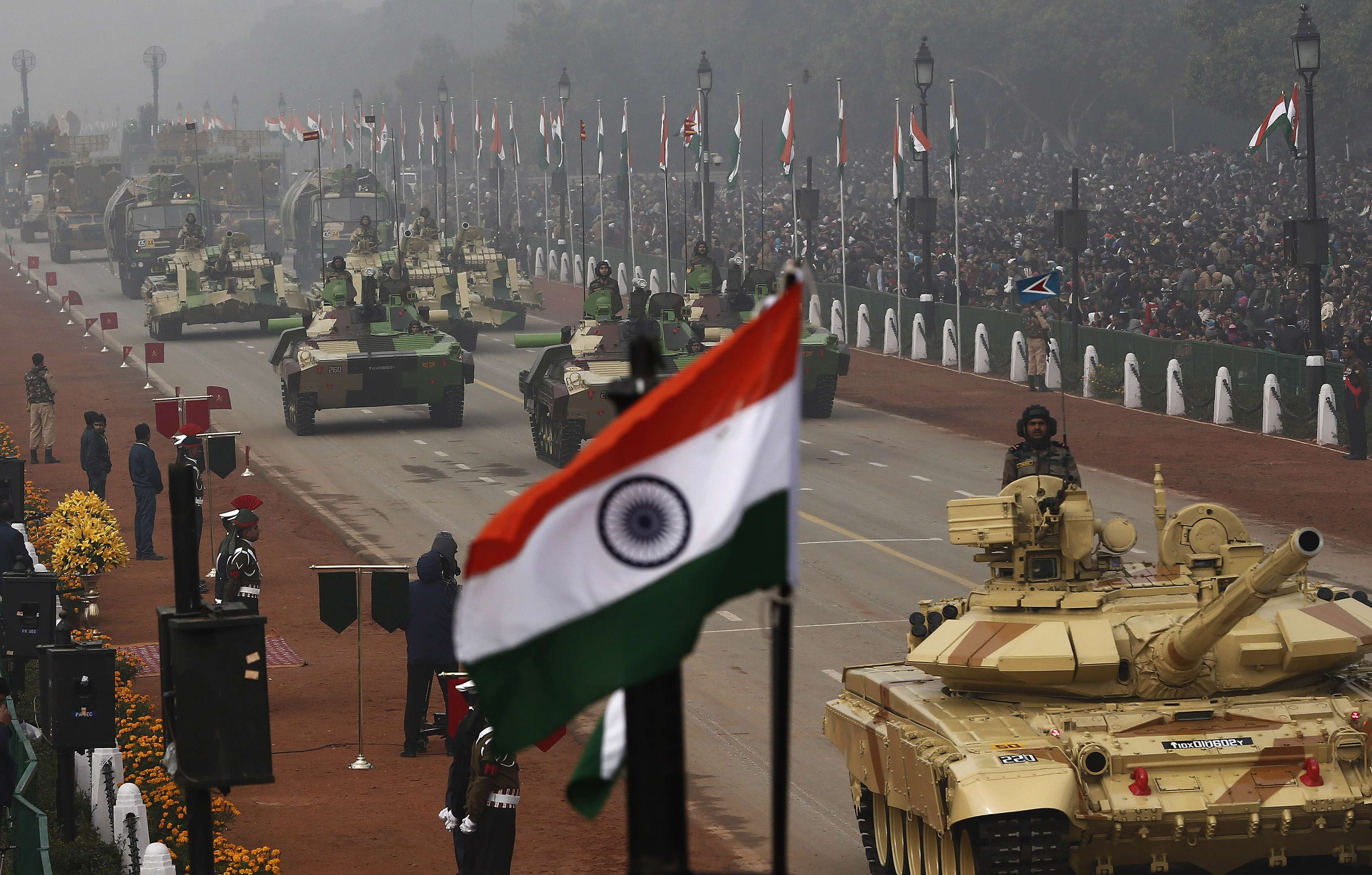 Indian Army's Arjun MK-I tanks (MBTs) are driven for display during the Republic Day parade in New Delhi January 26, 2014. India celebrated its 65th Republic Day on Sunday. REUTERS/Adnan Abidi (INDIA - Tags: MILITARY ANNIVERSARY POLITICS)