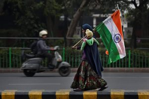 New Delhi: A woman sells the Indian national flag on a roadside ahead of Republic Day, in New Delhi on Wednesday. (PTI Photo by Ravi Choudhary)(PTI1_24_2018_000293B)