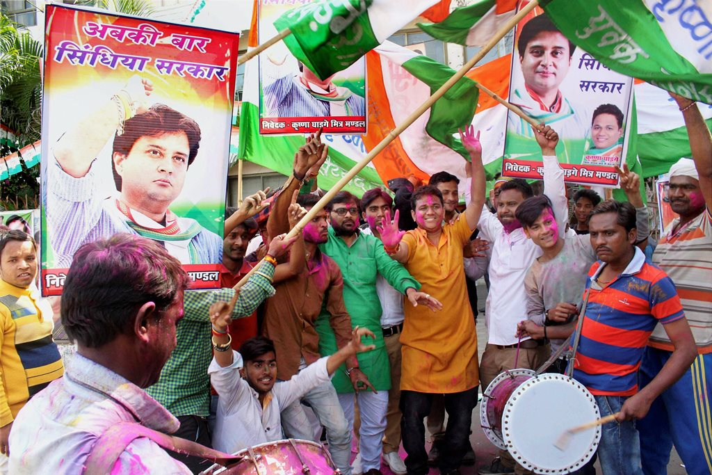 Bhopal: Congress party workers celebrate the party's victory in Kolaras and Mungaoli state assembly by-elections at the party's state headquarters in Bhopal on Wednesday. PTI Photo  (PTI2_28_2018_000075B)