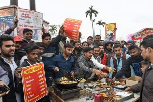 Lucknow: Youth claiming to be unemployed sell 'Pakoras' to counter Prime Minister Narendra Modi's statement on employment, in an old area of Lucknow on Wednesday. PTI Photo by Nand Kumar(PTI2_7_2018_000178B)