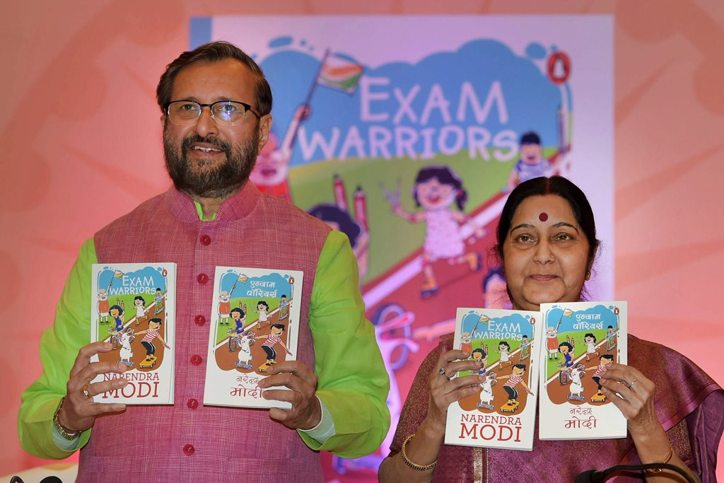 "New Delhi: External Affairs Minister Sushma Swaraj with Union HRD Minister Prakash Javadekar releases Prime Ministrer Narendra Modi's book ""Exam Warriors"" at a function in New Delhi on Saturday. PTI Photo by Shahabaz Khan (PTI2_3_2018_000119B)"
