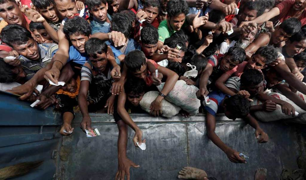 Rohingya refugees wait to receive aid in Cox's Bazar, Bangladesh | Reuters