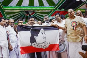 Madurai: Sidelined AIADMK leader TTV Dhinakaran launches the party flag which consists of a photo of former TN chief minister J Jayalalitha during the launch of his political party Amma Makkal Munnetra Kazhagam in Madurai on Thursday. PTI Photo (PTI3_15_2018_000041B)