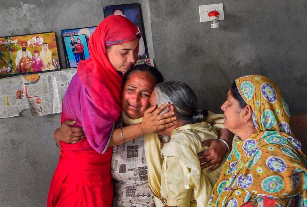 Amritsar: Family members of one of the 39 Indian workers feared killed in Iraq, grieve at their home on the outskirts of Amritsar on Tuesday. External Affairs Minister Sushma Swaraj in a statement made at Rajya Sabha today, stated that the 39 bodies exhumed from a mount in Badoosh in Iraq have been identified as those of abducted Indians and will be brought back to India on a special plane. PTI Photo(PTI3_20_2018_000156B)