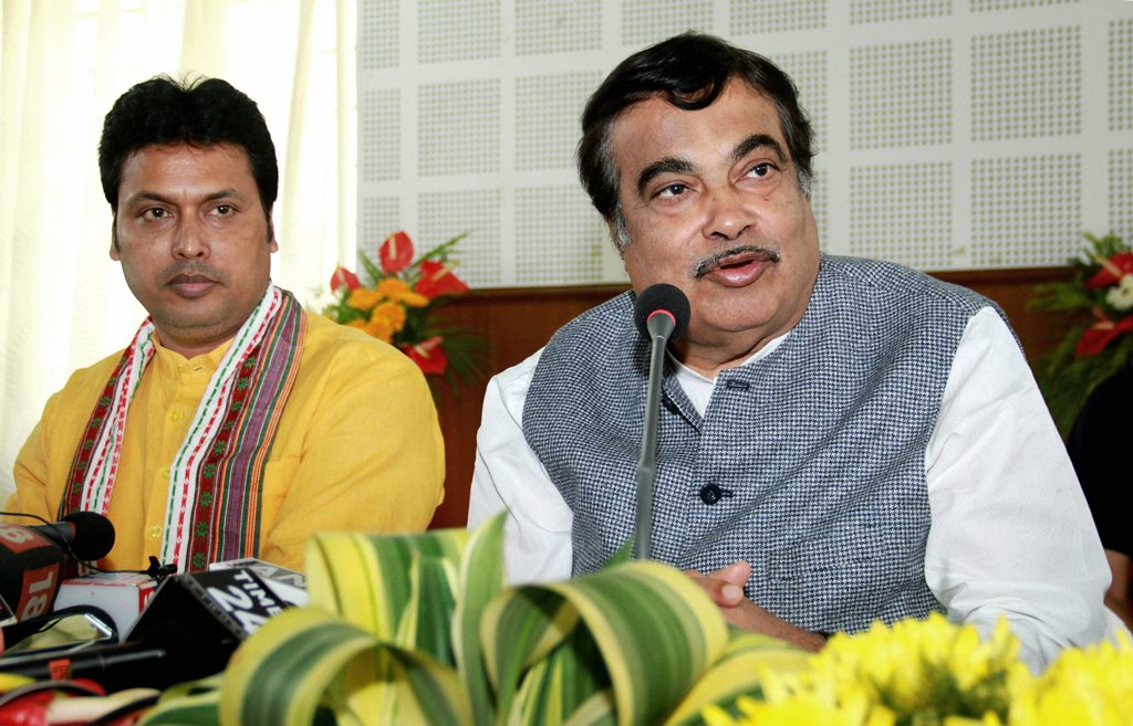 Agartala: Senior BJP leader and Union minister Nitin Gadkari addresses the media in a party meeting, in Agartala on Tuesday. Also seen is Tripura BJP President and Chief Minister-designate Biplab Deb. PTI Photo (PTI3_6_2018_000092B)