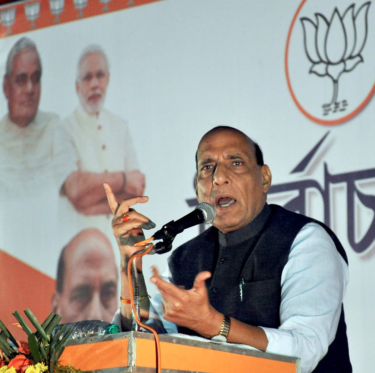 Agartala: Home Minister Rajnath Singh addresses a gathering during the Tripura assembly election campaign, at Agartala on Saturday. PTI Photo (PTI2_3_2018_000169B)