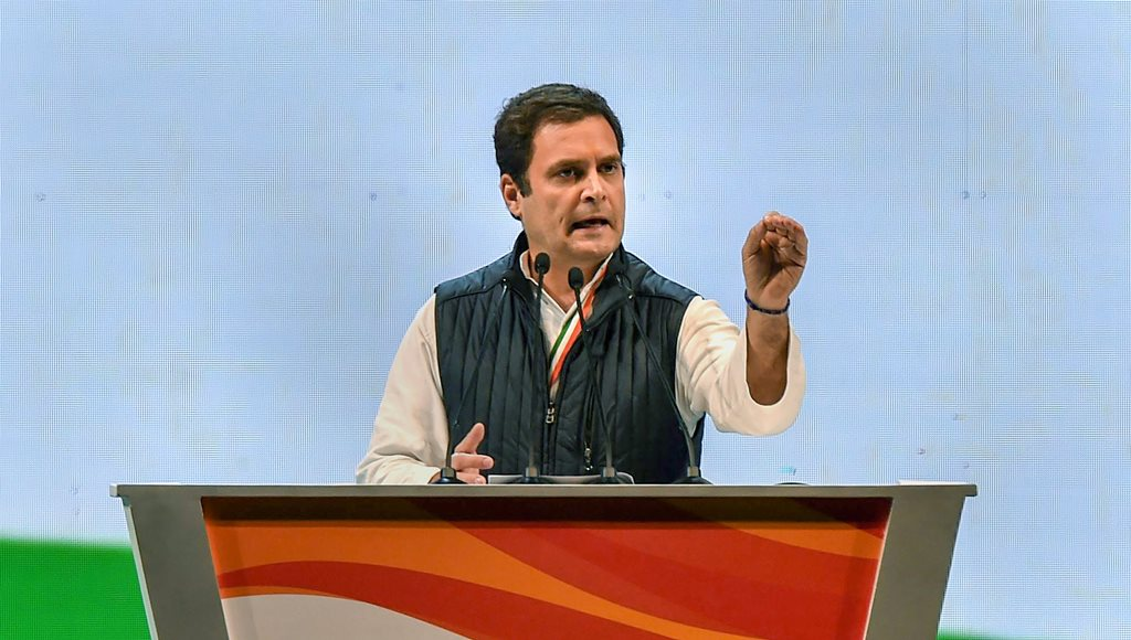 New Delhi: Congress President Rahul Gandhi speaks during the second day of the 84th Plenary Session of Indian National Congress (INC), at the Indira Gandhi stadium in New Delhi on Sunday. PTI Photo by Manvender Vashist(PTI3_18_2018_000116B)