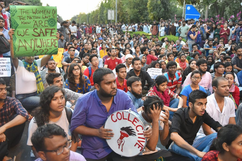 New Delhi: JNU students raise slogans over the issue of compulsory attendance at a protest in New Delhi on Friday. PTI Photo by Kamal Kishore (PTI3_23_2018_000197B)