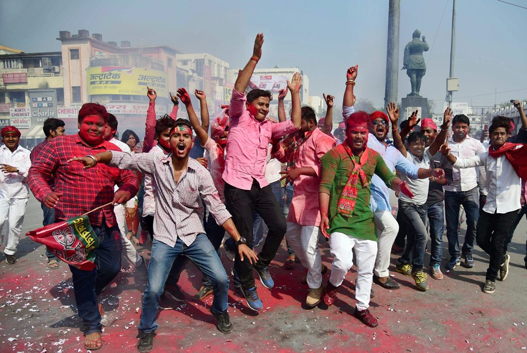 Allahabad: Samajwadi party workers celebrate their party success in Phulpur by-election, in Allahabad on Wednesday. PTI Photo(PTI3_14_2018_000064B)