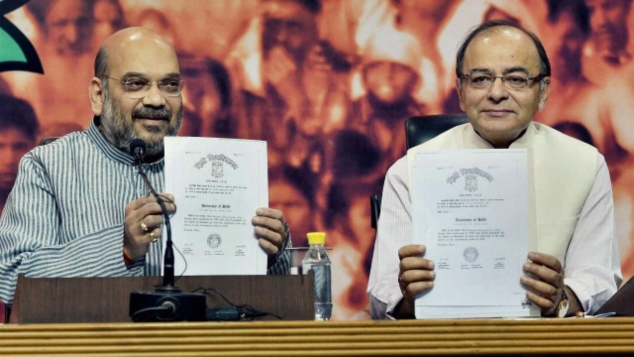 amit-shah-arun-jaitley-with-modis-degrees-pti