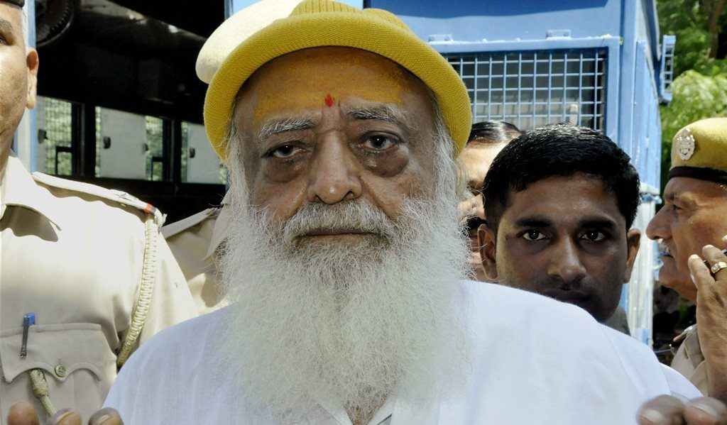 **FILE** New Delhi: File photo of Asaram Bapu being produced in Jodhpur court in connection with the sexual harassment case. A Jodhpur court on Wednesday convicted self-styled godman Asaram of raping a minor girl at his ashram in Rajasthan in 2013. PTI Photo PTI Photo(PTI4_25_2018_000033B)