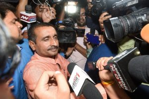 Lucknow: BJP MLA from Unnao Kuldip Singh Sengar, accused in a rape case, surrounded by media persons outside the office of the Senior Superintendent of Police in Lucknow on Wednesday night. PTI Photo by Nand Kumar(PTI4_12_2018_000001B)