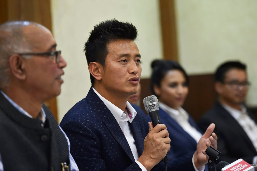 New Delhi: Former Indian football team captain Bhaichung Bhutia speaks during the launch of his political party 'Hamro Sikkim' during a press conference in New Delhi on Thursday. PTI Photo by Arun Sharma (PTI4_26_2018_000103B)
