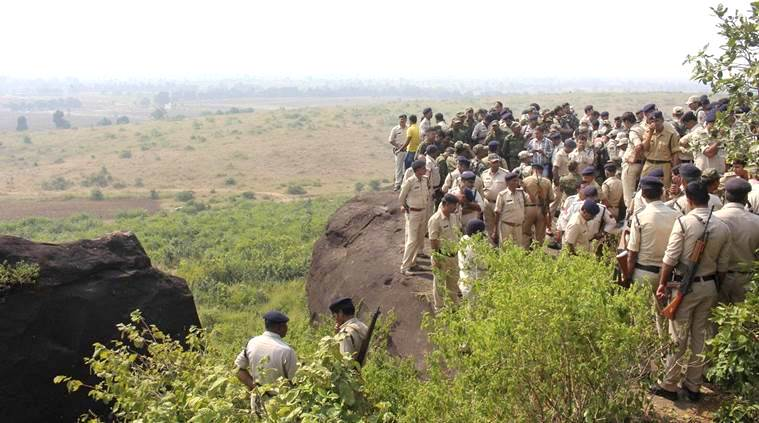 Bhopal: Police investigate the encounter site at the hillocks of Acharpura village after the STF killed 8 Students of Islamic Movement of India (SIMI) activists who escaped Central Jail killing a security guard in Bhopal on Monday. PTI Photo (PTI10_31_2016_000210B)