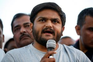 Ahmedabad: PAAS convener Hardik Patel addresses people during protest against Rape of 8yr old girl in Kathua of Jammu-Kashmir, 11 yr old girl in Unnao of Uttar Pradesh and also in Surat and demanding to hang rapists, in Ahmedabad on Sunday. PTI Photo (PTI4_22_2018_000167B)