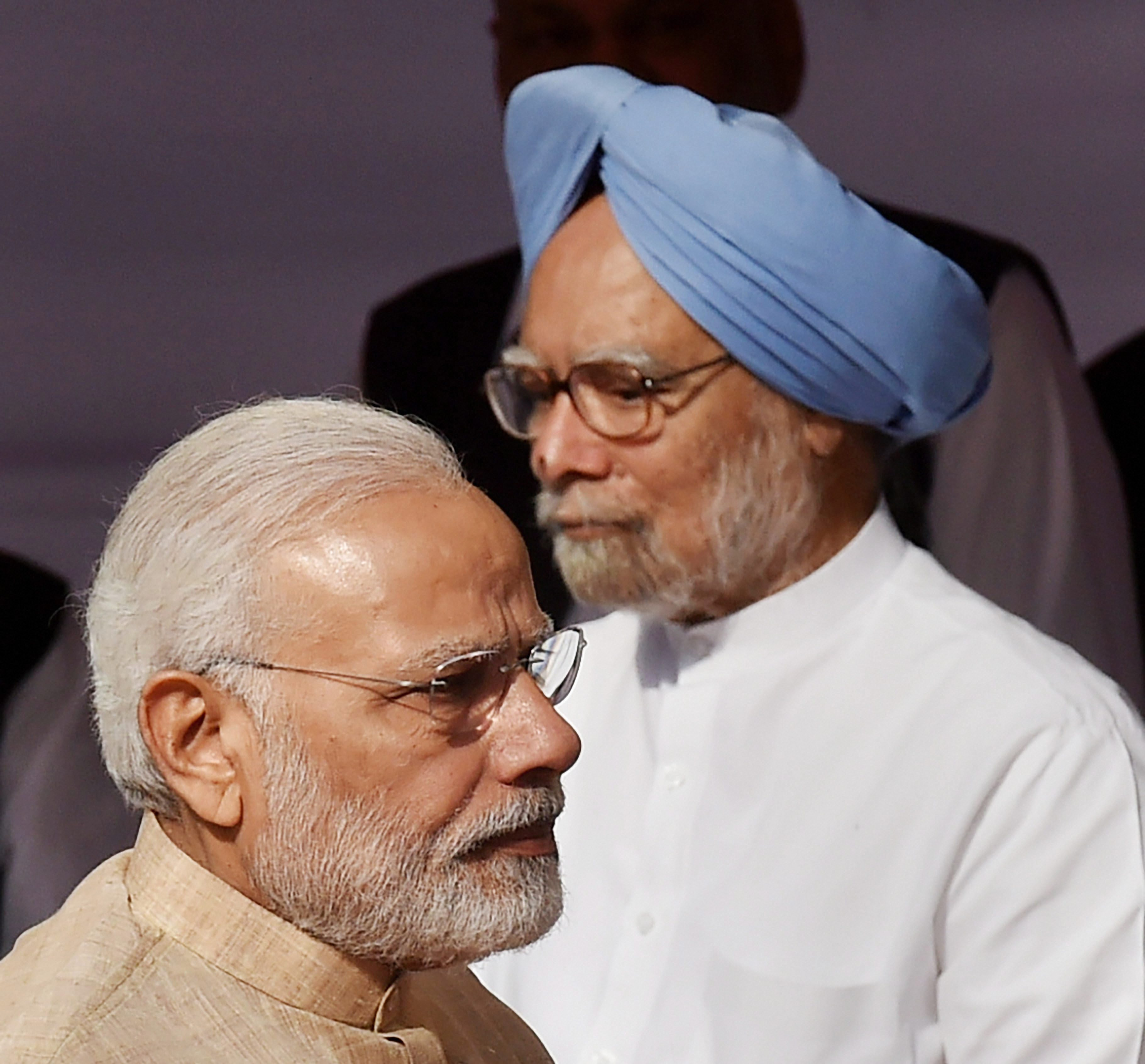 New Delhi: Prime Minister Narendra Modi and former prime minister Manmohan Singh after paying tributes to Babasaheb B R Ambedkar on the occasion of his 127th birth anniversary, at Parliament House in New Delhi on Saturday. PTI Photo by Atul Yadav (PTI4_14_2018_000022B)