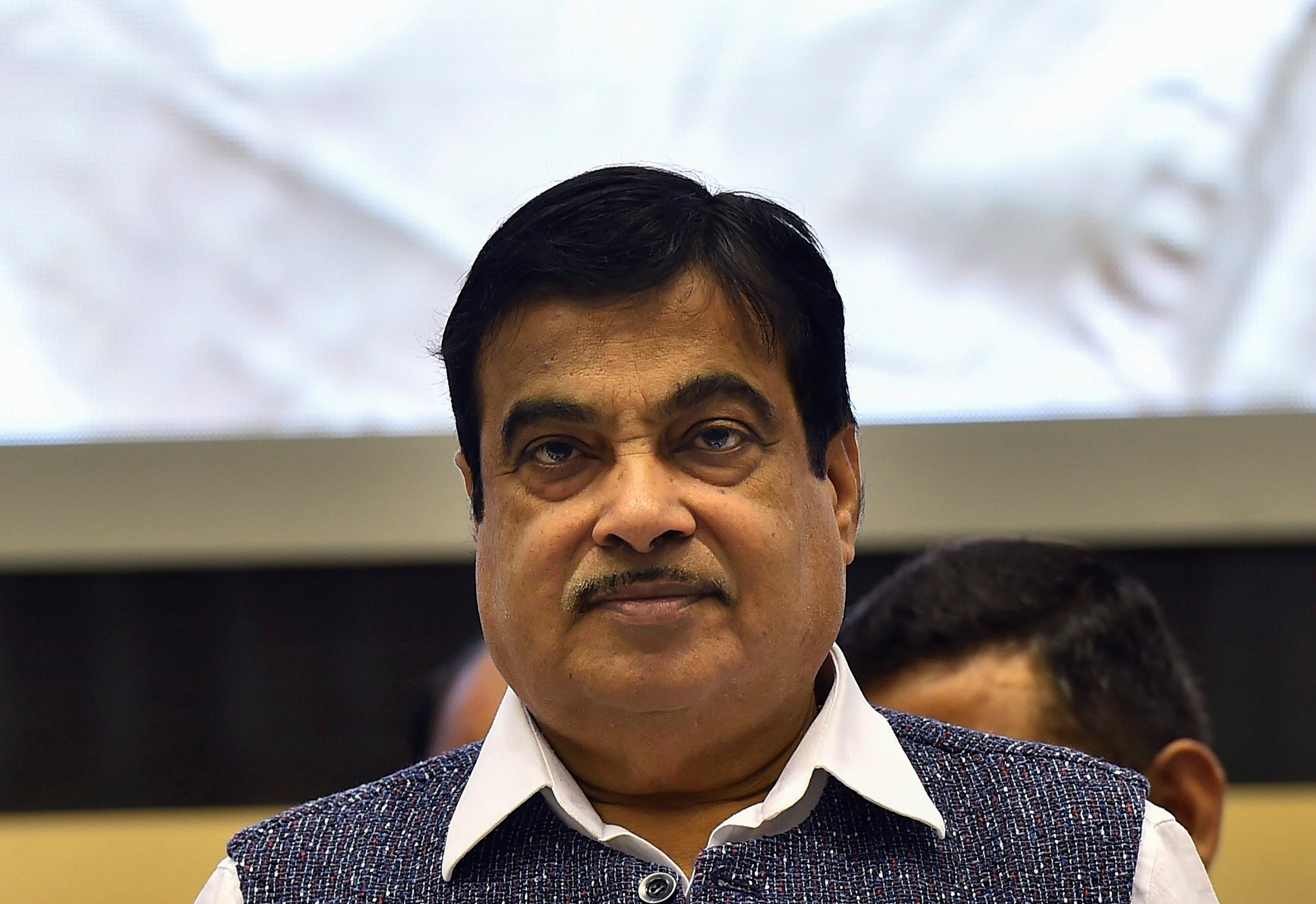 New Delhi: Union Minister for Road Transport and Highways Nitin Gadkari releases a book during inauguration of the 29th National Road Safety Week 2018 in New Delhi on Monday. PTI Photo by Kamal Singh (PTI4_23_2018_000031B)