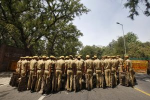 Police stand guard outside the residence of the Chief of India's ruling Congress party Sonia Gandhi during a protest in New Delhi May 2, 2013. Hundreds of Sikh protesters on Thursday held a demonstration outside the residence of Sonia Gandhi against the acquittal of Congress leader Sajjan Kumar in a 1984 anti-Sikh riots case, protesters said. More than 2,500 people died in a wave of attacks on Sikhs in 1984 after the then Prime Minister Indira Gandhi was shot dead by her Sikh bodyguards. REUTERS/Mansi Thapliyal (INDIA - Tags: CRIME LAW POLITICS CIVIL UNREST) - RTXZ7AY