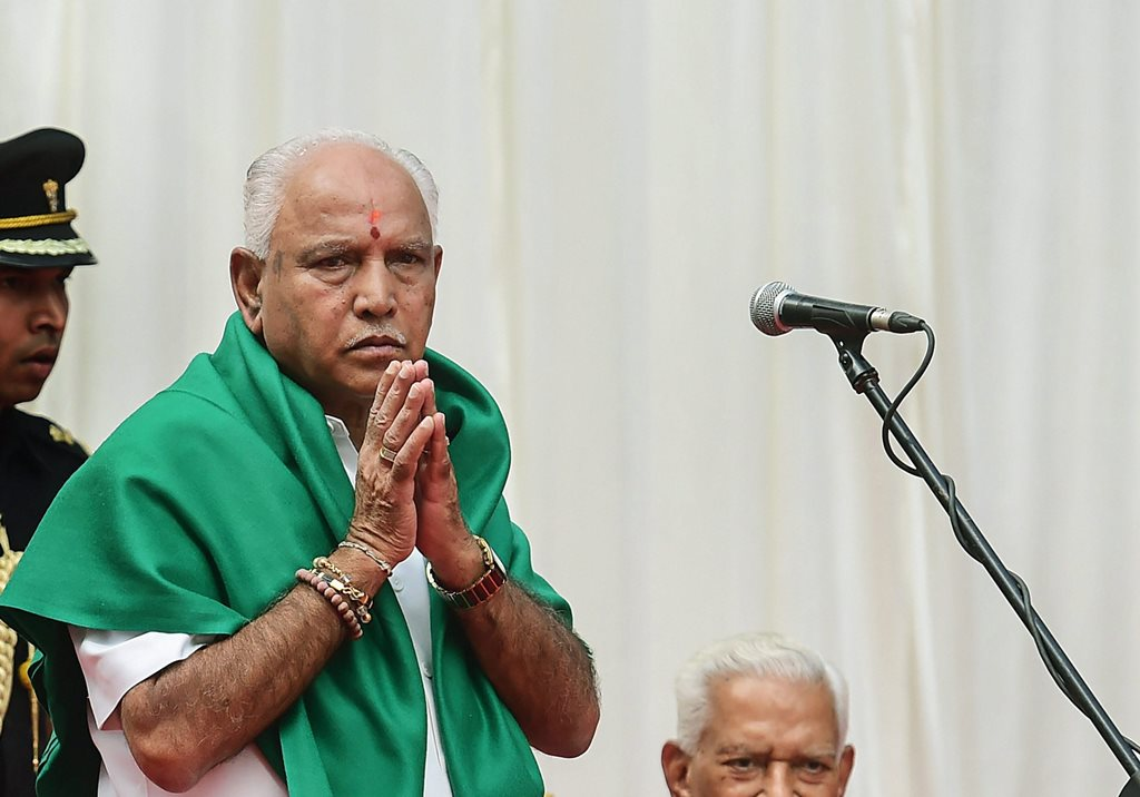 Bengaluru: BJP's B. S. Yeddyurappa gestures after he was sworn-in as Karnataka Chief Minister by Governor Vajubhai Vala (R) at a ceremony in Bengaluru on Thursday. (PTI Photo/Shailendra Bhojak)(PTI5_17_2018_000068B)