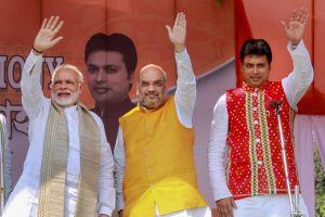 EDS PLS TAKE NOTE OF THIS PTI PICK OF THE DAY::::::::: Agartala: Prime Minister Narendra Modi with Bharatiya Janata Party (BJP) National President Amit Shah, new Tripura Chief Minister Biplab Kumar Deb during the swearing-in ceremony of the newly elected ministers , in Agartala on Friday. PTI Photo(PTI3_9_2018_000129B)(PTI3_9_2018_000205B)