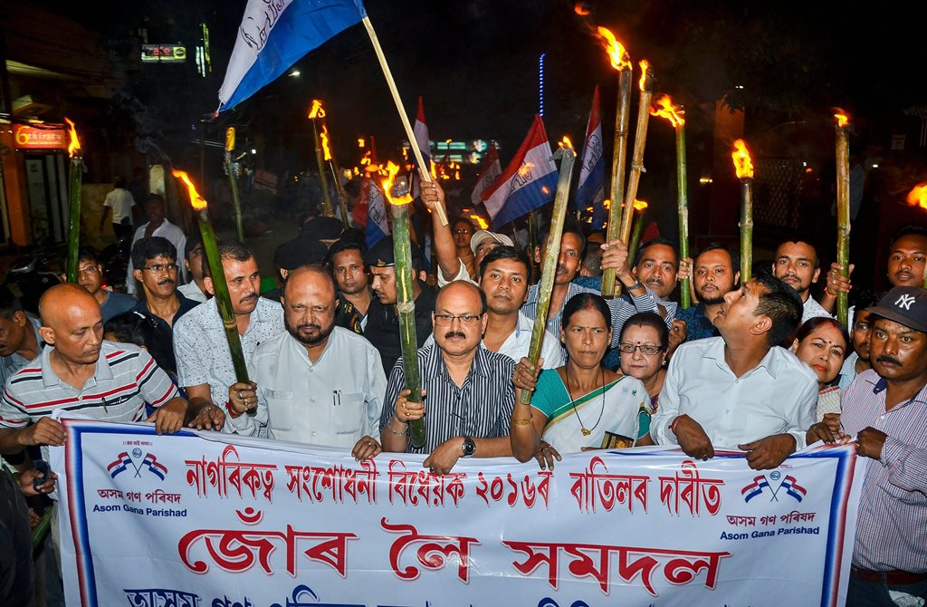 Guwahati: Activists of Asom Gana Parishad (AGP) led by former Assam chief minister Prafulla Kumar Mahanta take out a torch light rally objecting to Citizenship (Amendment) Bill, 2016 in Guwahati on Friday. PTI Photo (PTI5_11_2018_000210B)