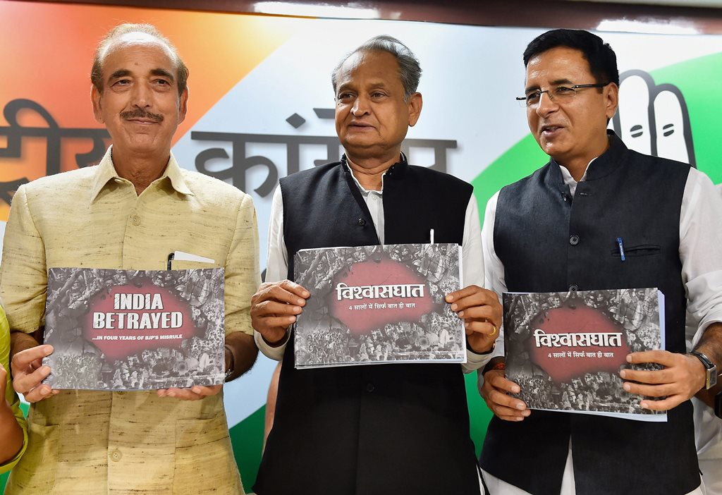 "New Delhi: Senior Congress leaders Ghulam Nabi Azad, Ashok Gehlot, AICC National Spokesperson Randeep Singh Surjewala and All India Mahila Congress President Sushmita Dev release a booklet ""India Betrayes ... In Four Years of BJP's Misrule"" during a press conference, in New Delhi on Saturday. (PTI Photo/Kamal Singh) (PTI5_26_2018_000059B)"