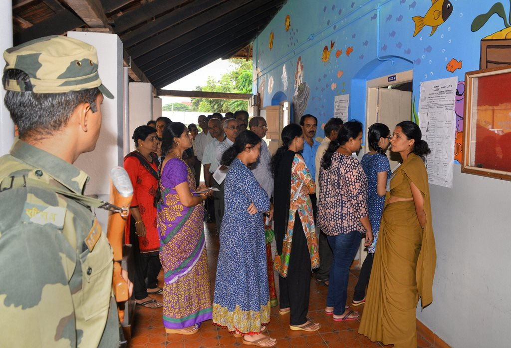Mangaluru: Voters stand in a queue to cast their votes for Karnataka Assembly election 2018 at a polling station in Mangaluru on Saturday. (PTI Photo)(PTI5_12_2018_000026B)