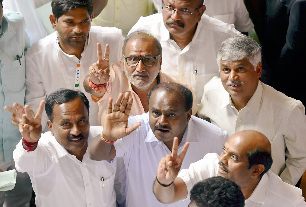 Bengaluru: JD(S) leader HD Kumaraswamy and party MLAs show victory sign to celebrate after chief minister BS Yediyurappa announced his resignation before the floor test, at Vidhana Soudha, in Bengaluru, on Saturday. Supreme Court had ordered Karnataka BJP Government to prove their majority in a floor test at the Assembly .(PTI Photo/Shailendra Bhojak) (PTI5_19_2018_000111B)