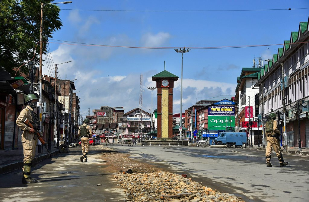Srinagar: Security personnel stand guard during restrictions and strike called by separatists against Prime Minister Narendra Modi's visit to the state, at Lal Chowk, in Srinagar, on Saturday. (PTI Photo/S Irfan) (PTI5_19_2018_000049B)