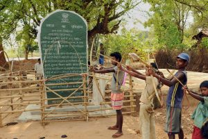 "Khunti: Tribals hold bows and arrows near a Patthalgarhi spot at Maoist-affected village Siladon under Khunti district of Jharkhand on Tuesday. The Patthalgarhi movement says that the ""gram sabha"" has more weight than either the Lok Sabha or the Vidhan Sabha in scheduled areas. PTI Photo (PTI5_1_2018_000146B)"
