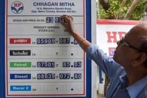 Mumbai: A petrol pump employee adjusts the fuel rate card as the price reaches highest-ever, in Mumbai, on Wednesday. (PTI Photo/Shashank Parade) (PTI5_23_2018_000069B)