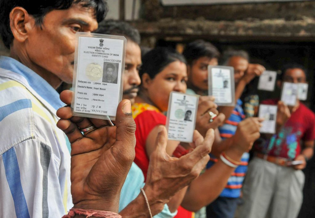 South 24 Parganas: Voters show their Election Commission cards as they queue to cast their vote at a polling station during Maheshtala Assembly by-election, at Maheshtala in South 24 Parganas district of West Bengal, on Monday, 28 May 2018. (PTI Photo)(PTI5_28_2018_000041B)