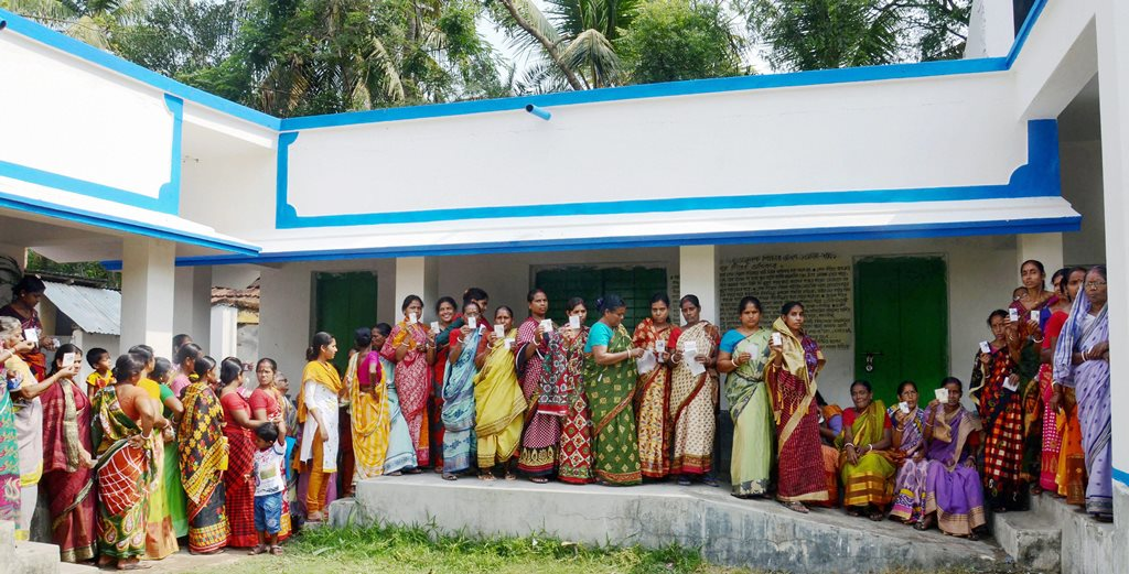 Howrah: Women stand in a queue to cast their vote for Panchayat election at a polling station in Howrah district on the outskirts of West Bengal on Monday. PTI Photo (PTI5_14_2018_000037B)