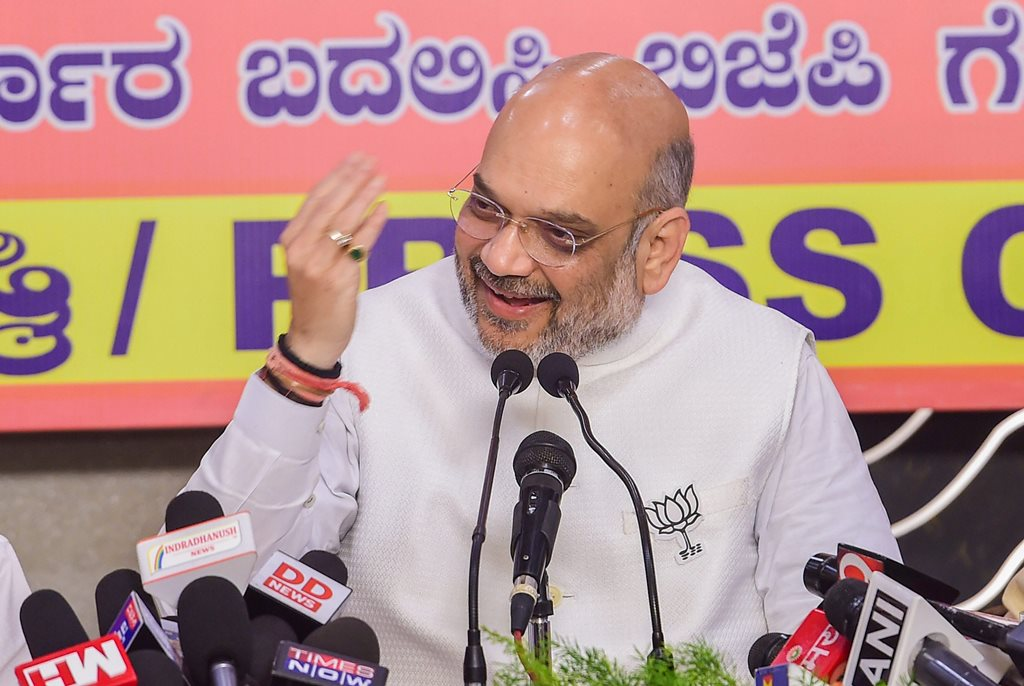 Bengaluru: BJP National President Amit Shah addresses a press conference ahead of Karnataka Assembly election 2018 in Bengaluru on Thursday. PTI Photo by Shailendra Bhojak
