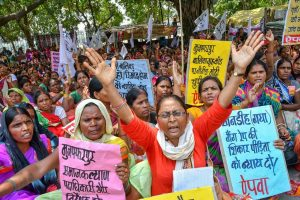 Patna: All India Progressive Women's Association (AIPWA) activists raise slogans as they protest against atrocities on women, in Patna on Friday, June 22, 2018. (PTI Photo) (PTI6_22_2018_000026B)