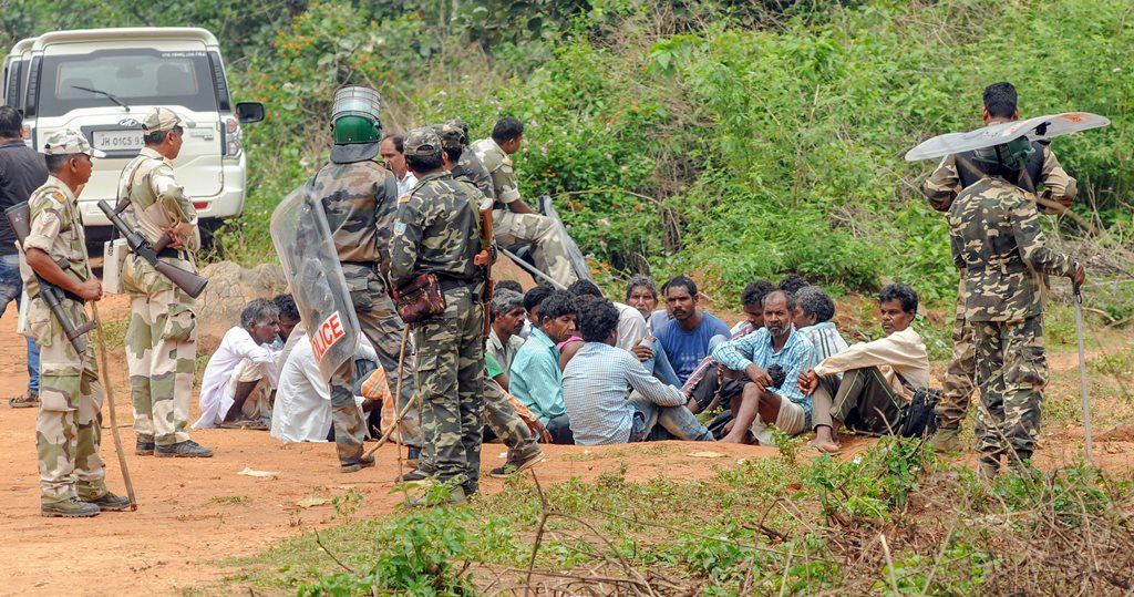 Khunti: Security personnel detain villagers while carrying out a search operation at the remote village Ghagra, where Member of Parliament (MP) Karia Munda's three bodyguards, belonging to Jharkhand Police, were allegedly kidnapped by Pathalgarhi supporters, in Khunti district on Wednesday, June 27, 2018. (PTI Photo) (PTI6_27_2018_000171B)